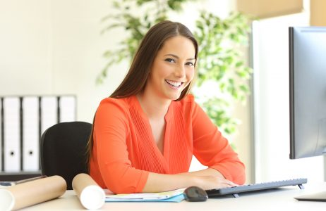 Clerical Worker Sitting at Office Desk