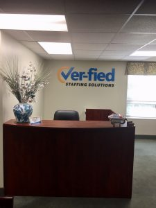 Ver-fied staffing solutions logo in office